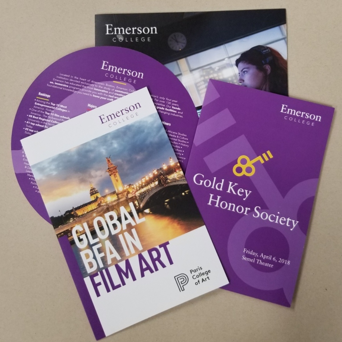 Selection of purple and gold Emerson College digitally printed materials