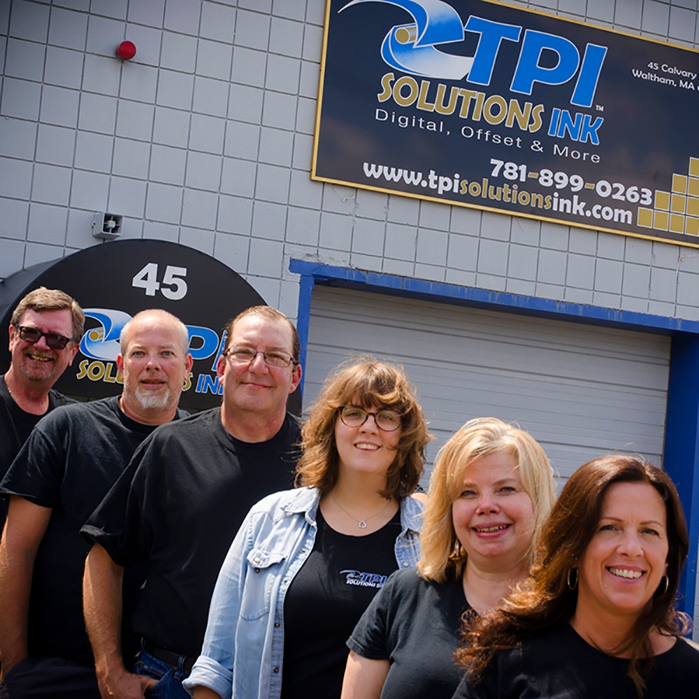 TPI Solutions Ink employee team in front of print shop in Waltham