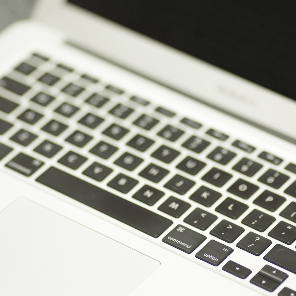 Macbook pro keyboard demonstrating graphic design services